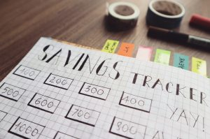 savings-tracker-on-brown-wooden-surface-732444